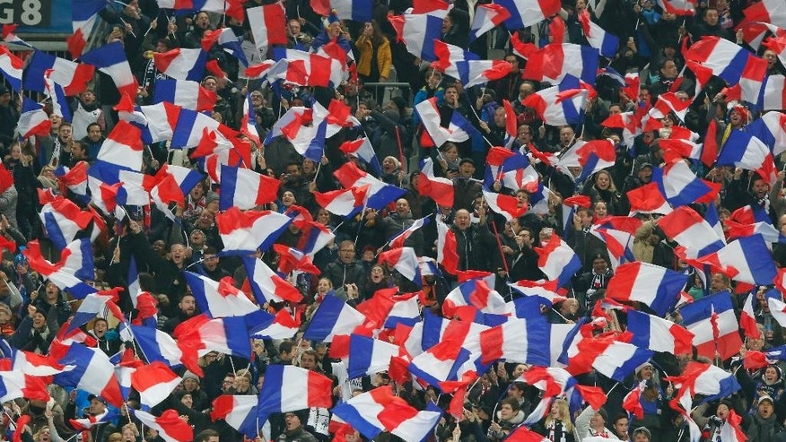French supporters wave their national flags prior to the World Cup Group A qualifying match between France and Sweden at the Stade de France stadium in Saint-Denis, outside Paris, on Friday Nov. 11, 2016. (AP Photo/Michel Euler)
