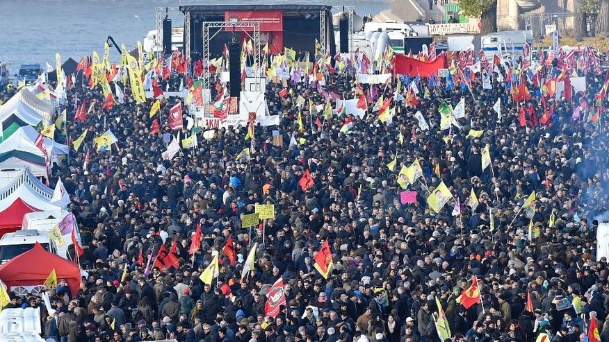Pro-Kurdish  demonstrators protest  against Turkish president Recep Tayyip Erdogan and the political repression that followed July's failed military coup,  in Cologne, Germany Saturday, Nov. 12, 2016.   (AP Photo/Martin Meissner)