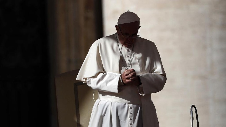 Pope Francis prays during a Jubilee audience in St. Peter's Square, at the Vatican, Saturday, Nov. 12, 2016. (AP Photo/Gregorio Borgia)