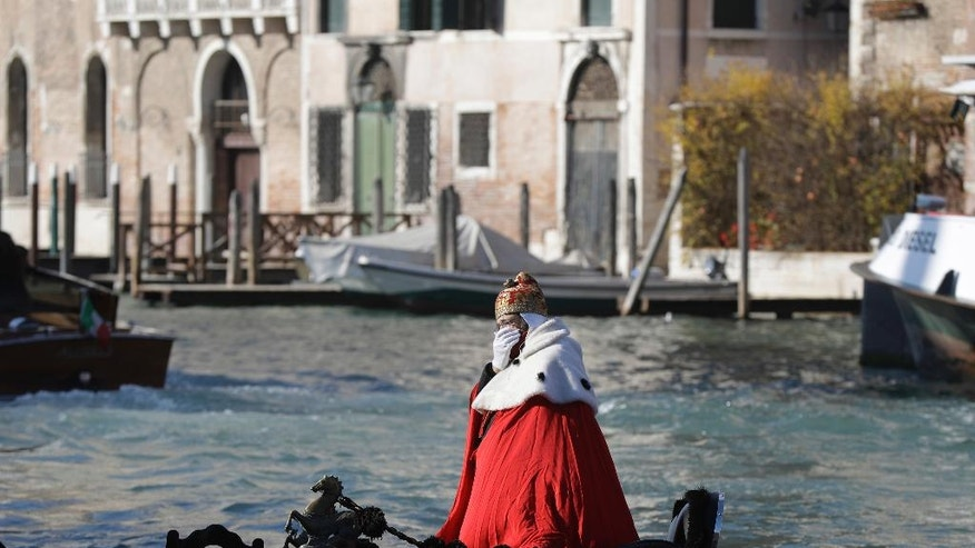 "A protester on a gondola impersonates the ""Doge of Venice"" during a demonstration against the increasing number of tourists in Venice, Italy, Saturday, Nov.12. 2016. For decades, the number of Venetians have dwindled steadily and numerous factors are blamed _ high prices driven by a boom in tourism and the logistics of supplying a carless city and erosion by lapping waters among them. (AP Photo/Luca Bruno)"
