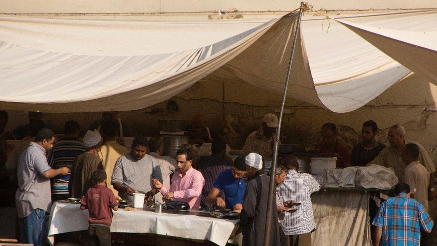 "In this Thursday, Oct. 27, 2016 picture, Egyptians eat fava beans, a cheap and filling breakfast staple, at an open-air restaurant in Cairo, Egypt. Egypt's shock therapy reforms are rewriting the social contract that long ruled the country _ ""accept autocracy, receive bread."" The currency has dropped in value after being floated, and subsidies have been cut, hiking prices on the poor. Now some demand political reforms and a lifting of the heavy security hand in turn, but it seems unlikely.(AP Photo/Amr Nabil)"