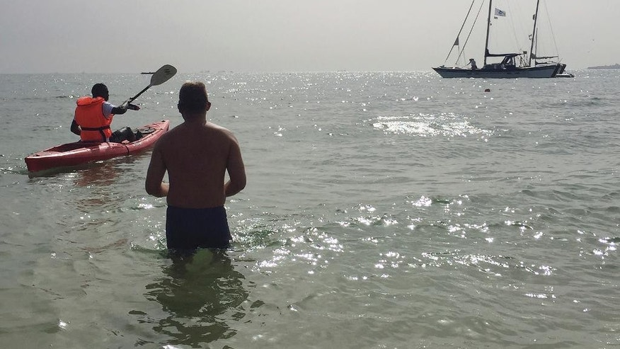 Ben Hooper, 38, looks out from the shallows before his cross Atlantic swimming expedition in Dakar, Senegal, Sunday, Nov. 13, 2016.   Ben Hooper has been planning to make the epic endeavour for more than three years to become the first person to swim the full 1,635 nautical miles from Senegal to Brazil. (AP Photo/Carley Petesch)
