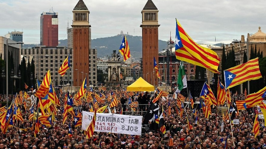"Pro independence supporters wave ""estelada"" or pro independence flags, during protest against a series of legal challenges made by Spain's government against pro-independence Catalan politicians in Barcelona, Spain, Sunday, Nov.13, 2016. Several of Catalonia's lawmakers are facing court cases sought by the Spanish government for having staged a secession referendum in 2014 in disobedience of a court order and for other regional laws designed to prepare a path toward secession. (AP Photo/Manu Fernandez)"