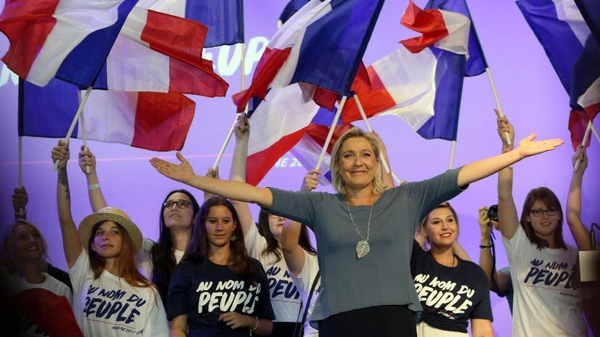 FILE - In this Sept. 18, 2016 file photo, France's far-right National Front president Marine Le Pen waves to supporters during a summer meeting in Frejus, southern France. Le Pen said in an interview broadcast on the BBC on Sunday, Nov. 13, 2016, that Donald Trump's victory in the U.S. boosts her own chances during next year's French presidential election. (AP Photo/Claude Paris, File)