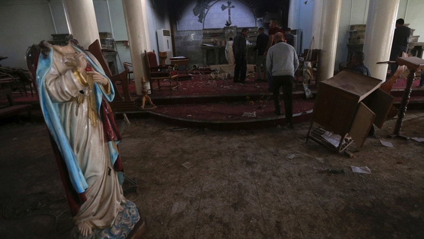 Nov. 13, 2016: Iraqi Christian citizens check the St. Addai church which was damaged by Islamic State fighters during their occupation of Keramlis village, less than 18 miles southeast of Mosul.