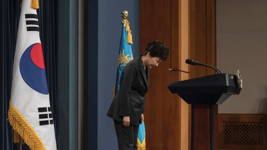 "FILE - In this Friday, Nov. 4, 2016 file photo, South Korean President Park Geun-hye bows before addressing the nation over a  ""heartbreaking"" scandal at the presidential Blue House in Seoul. South Korean prosecutors are likely to question Park over suspicion that she let a shadowy longtime confidante manipulate power from behind the scenes, state-run Yonhap news agency reported Sunday, Nov. 13. (Ed Jones/Pool Photo via AP, File)"