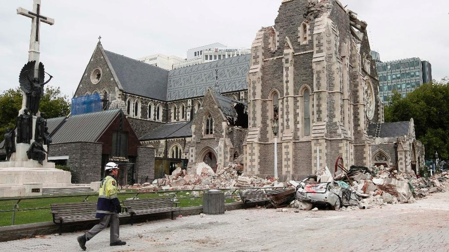FILE - In this Feb. 26, 2011 file photo, a relief worker walks past the earthquake-damaged Christchurch Cathedral in Christchurch, New Zealand following a magnitude 6.3 temblor. A powerful earthquake struck New Zealand on Monday, Nov. 14, 2016, reminding many of the quake that hit the nation in February 2011 and devastated the city of Christchurch, the country's second-biggest city. (AP Photo/Mark Baker, File)