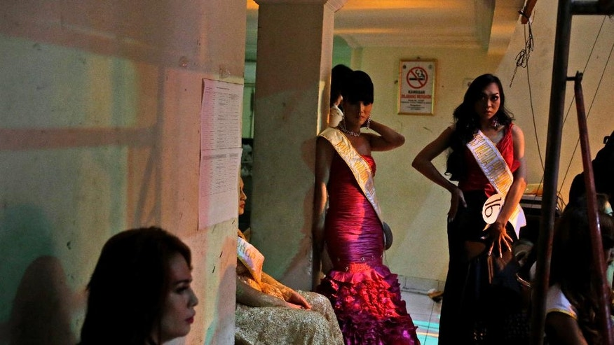 In this Friday, Nov. 11, 2016 photo, contestants wait backstage during a Miss Transgender Indonesia pageant in Jakarta, Indonesia. Transgender people and gay activists from across Indonesia have defied a wave of hatred against sexual minorities to crown a Miss Transgender at the national pageant held in absolute secrecy. (AP Photo/Dita Alangkara)