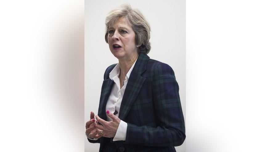 "British Prime Minister Theresa May talks during a visit to Diabetes UK, where she opened their new charity headquarters in east London, Monday Nov. 14, 2016.  Britain will be a ""global champion of free trade,"" according to details of a speech by Prime Minister Theresa May released Monday, acknowledging that the U.S. election of Donald Trump and the U.K. vote to leave the European Union mark an era of profound world change. (Jack Taylor / PA via AP)"