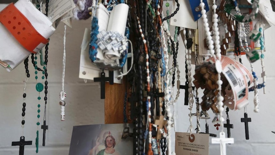 Dozens of migrant detention center bracelets and rosaries hang from a cross inside a migrant shelter in Ciudad Juarez, Monday, Nov. 14, 2016. Under proposals put forward by President-elect Donald Trump, the country could face a devastating triple whammy: Mexico would get millions streaming home with no jobs available; the country would lose the billions of dollars in remittances sent home each year, and some jobless deportees could swell the ranks of the drug cartels, worsening the problem of violence. (AP Photo/Christian Torres)