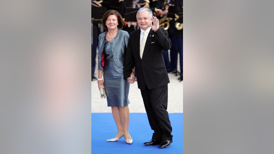 FILE - In this Sunday July 13, 2008 file photo, Polish President Lech Kaczynski and his wife Maria attend a formal dinner after a Mediterranean Summit meeting at the Petit Palais in Paris. The bodies of former Polish President Lech Kaczynski and his wife are to be removed from their tomb in Krakow after dark on Monday, the first of exhumations planned on most of the 96 prominent Poles killed in a plane crash in Russia in 2010. (AP Photo/Thibault Camus, File)