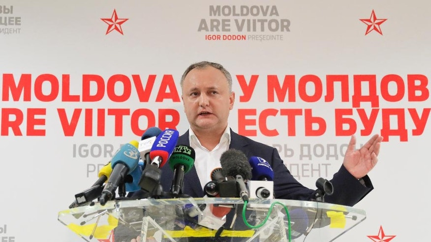 Socialist Party presidential candidate Igor Dodon gestures during a press briefing in Chisinau, Moldova, Sunday, Nov. 13, 2016. Dodon, the pro-Moscow candidate for president, has over 50 percent of the vote in Moldova's election Sunday and said he was headed to victory, with just under 98 percent of the vote counted.(AP Photo/Vadim Ghirda)