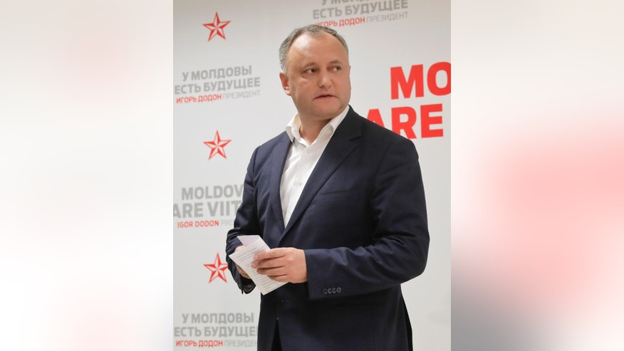 Socialist Party presidential candidate Igor Dodon leaves after a press briefing in Chisinau, Moldova, Sunday, Nov. 13, 2016. Dodon, the pro-Moscow candidate for president, has 54.53 percent of the vote in Moldova's election Sunday and said he was headed to victory, with just under 98 percent of the vote counted. (AP Photo/Vadim Ghirda)