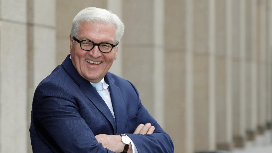 FILE - In this Oct. 26, 2016 file photo German Foreign Minister Frank-Walter Steinmeier laughs as he waits for the arrival of Palestinian Prime Minister Rami Hamdallah at the foreign ministry in Berlin, Germany. (AP Photo/Michael Sohn, file)