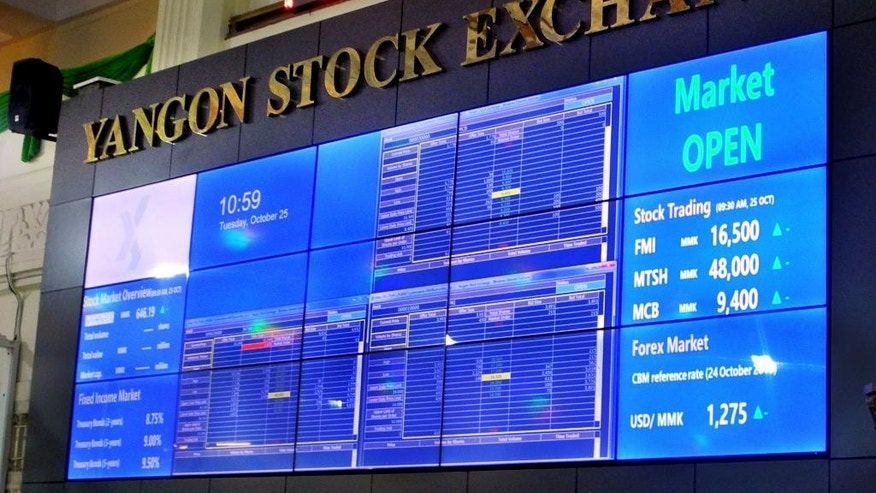In this Oct. 25, 2016, photo, the new Yangon Stock Exchange board is seen at the exchange headquarters in Yangon, Myanmar. Myanmar's stock exchange, the world's youngest, is going through teething problems: few listings, low trading volume, irrational investor behavior. But financial experts see a rosy future in a country with great economic potential following a half century of ruinous military rule. (AP Photo/Denis Gray)