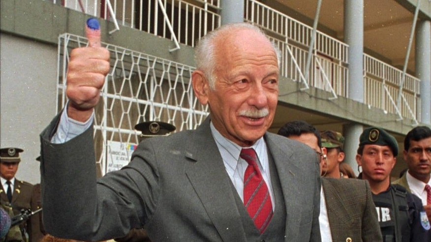 FILE In this May 19, 1996 file photo, Ecuadorean President Sixto Duran-Ballen shows his finger stained with ink after voting in Quito, Ecuador. The former president died Tuesday, Nov. 15, 2016, in his home in Quito while resting. He was 95.  (AP Photo/Marcelo Salinas, File)