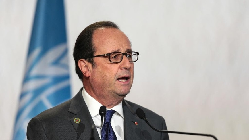 "France's President Francois Hollande speaks during the opening session of the high level segment of the U.N. climate climate conference in Marrakech, Morocco, Tuesday, Nov. 15, 2016. Hollande on Tuesday urged the United States to respect the ""irreversible"" Paris Agreement on climate change, and said France will lead a dialogue on the topic with President-elect Donald Trump ""on behalf of the 100 countries that have ratified"" the deal. (AP Photo/Mosa'ab Elshamy)"
