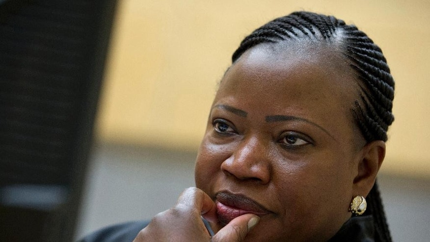 FILE - In this Nov. 27, 2013, file photo, prosecutor Fatou Bensouda waits for the start of the trial at the International Criminal Court (ICC) in The Hague, Netherlands. U.S. armed forces and the CIA may have committed war crimes by torturing detainees in Afghanistan, the International Criminal Court's chief prosecutor said in a report Monday, Nov. 14, 2016, raising the possibility that American citizens could be indicted even though Washington has not joined the global court. (AP Photo/Peter Dejong, File)