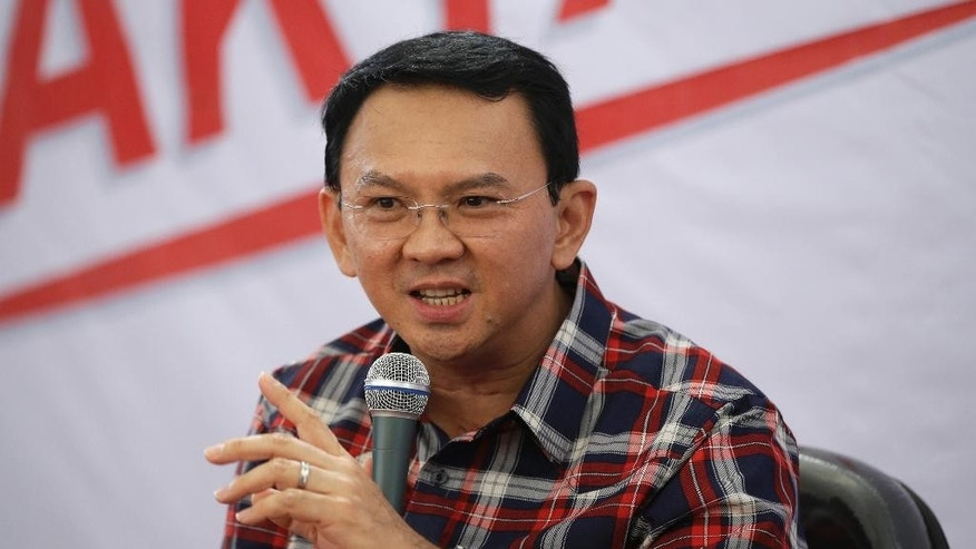 "Jakarta Governor Basuki Tjahaja Purnama, popularly known as ""Ahok,"" speaks during a campaign event in Jakarta, Indonesia, Wednesday, Nov. 16, 2016. Indonesian police on Wednesday named the minority Christian governor of the country's capital as a suspect in a blasphemy investigation in a major test of the Muslim-majority nation's reputation for religious tolerance. (AP Photo/Dita Alangkara)"