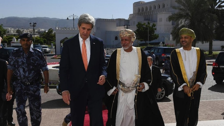 U.S. Secretary of State John Kerry, left, meets with the the Omani Minister Responsible for Foreign Affairs, Yusuf bin Alawi bin Abdullah, center, in Muscat, Oman, Monday, Nov. 14, 2016. (Mark Ralston via AFP, Pool)