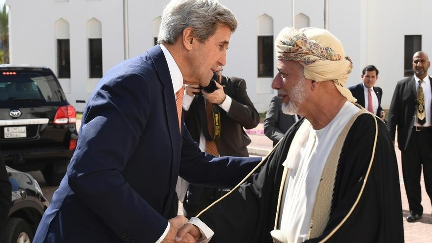 U.S. Secretary of State John Kerry, left, is greeted by the Omani Minister Responsible for Foreign Affairs, Yusuf bin Alawi bin Abdullah, in Muscat, Oman, Monday, Nov. 14, 2016. (Mark Ralston via AFP, Pool)