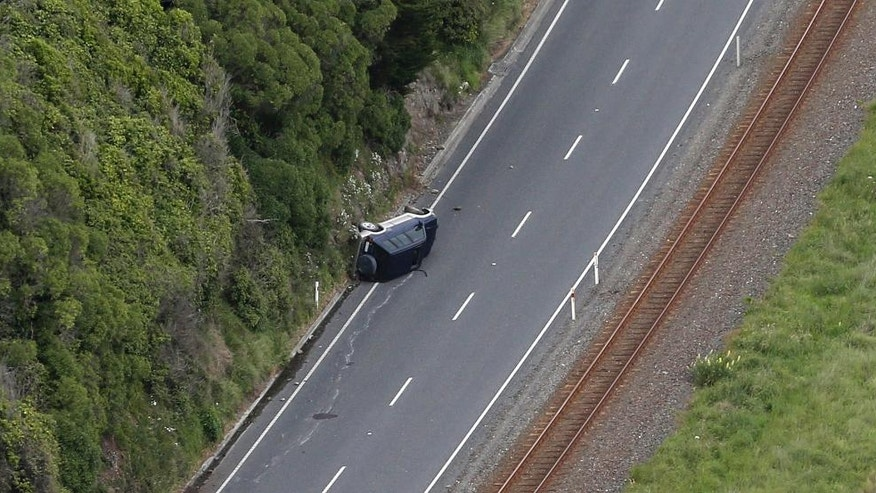 A car lies on its side on Highway One following an earthquake in the area, north of Kaikoura, New Zealand, Monday, Nov. 14, 2016. A powerful earthquake that rocked New Zealand on Monday triggered landslides and a small tsunami, cracked apart roads and homes and left two people dead, but largely spared the country the devastation it saw five years ago when a deadly earthquake struck the same region. (Mark Mitchell/New Zealand Herald Pool Photo via AP)