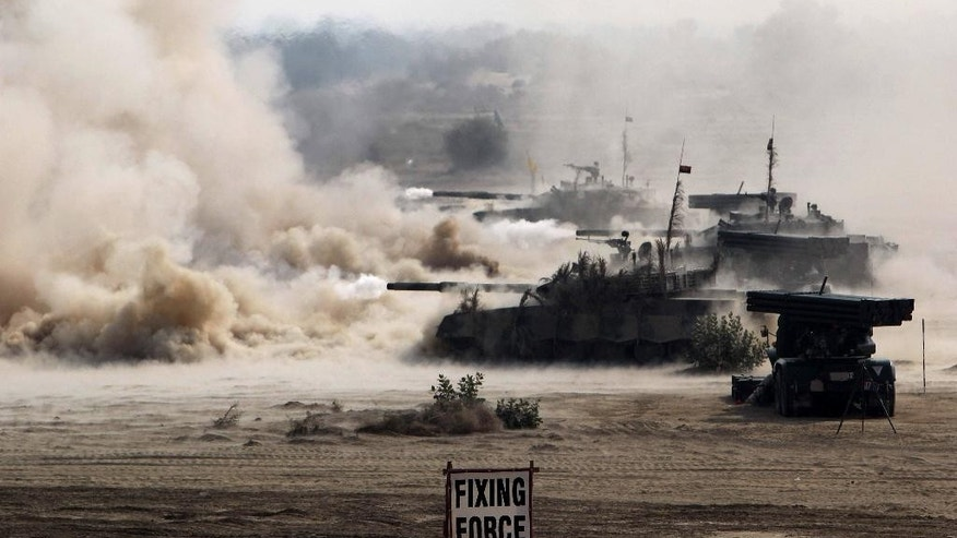 Pakistan army tanks take part in a military exercise in Khairpur Tamiwali, Pakistan Wednesday, Nov. 16, 2016. Sharif and army chief traveled Wednesday to a strategic area along the border with India to observe a drill meant to display the country's military might amid escalating tensions with New Delhi over the disputed Kashmir region. (AP Photo/Asim Tanveer)
