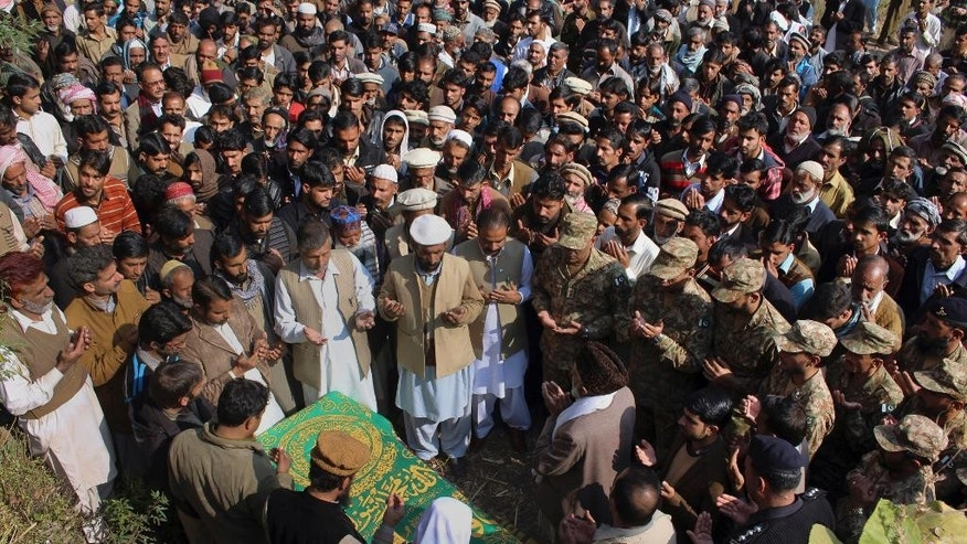 People pray during the funeral for a Pakistani soldier killed by Indian shelling, in the village of Solara, near Muzaffarabad, the capital of Pakistani controlled Kashmir, Tuesday, Nov. 15, 2016. Indian shelling has forced thousands of villagers from their homes in Pakistani-controlled Kashmir, a Pakistani lawmaker said. The evacuation from villages in the Bhimber district came after seven Pakistani soldiers were killed by Indian shelling on Monday. (AP Photo/M.D. Mughal)
