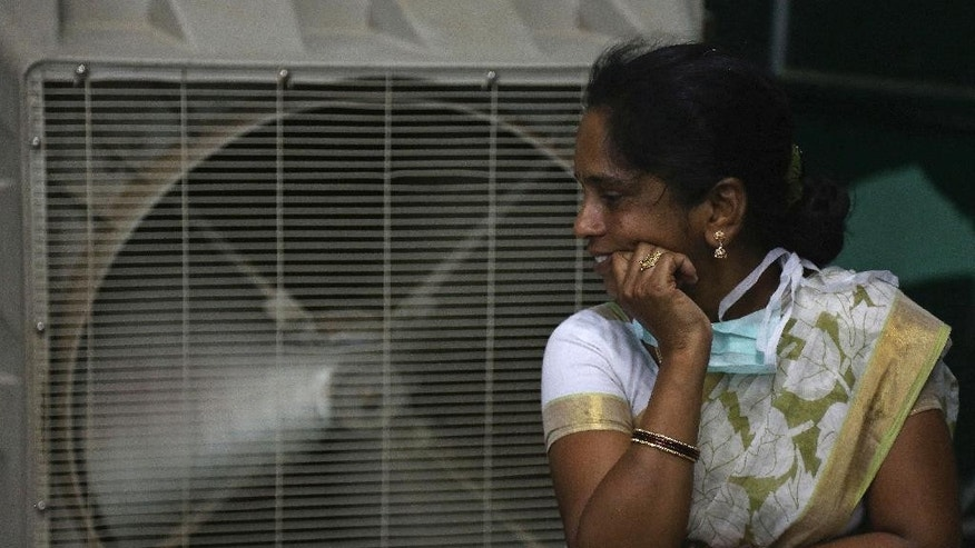 FILE - In this May 31, 2015 file photo, a woman cools herself on a hot summer day in Hyderabad, in the southern Indian state of Telangana.  The U.N. weather agency said on Monday, Nov. 14, 2016, that 2016 is set to break the record for the hottest year since measurements began in the 19th century. (AP Photo/Mahesh Kumar A., File)