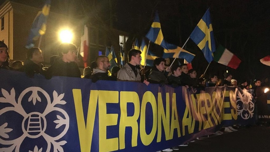 Protesters march in Soave, Northern Italy, Tuesday night, Nov. 15, 2016. More than a thousand people marched under torchlight through the medieval center of the winemaking town of Soave Tuesday night against the government's policy of accepting and housing migrants rescued at sea, emblematic of a wave of anti-migrant protests spreading through Italy's industrial north. (AP Photo/Paolo Santalucia)
