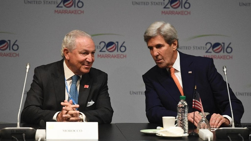 US Secretary of State John Kerry, right, talks with former Moroccan ambassador to the US Aziz Mekouar, during a Major Economies Forum meeting at the COP22 climate change conference in Marrakech, Wednesday, Nov 16, 2016. (Mark Ralston, Pool Photo via AP)