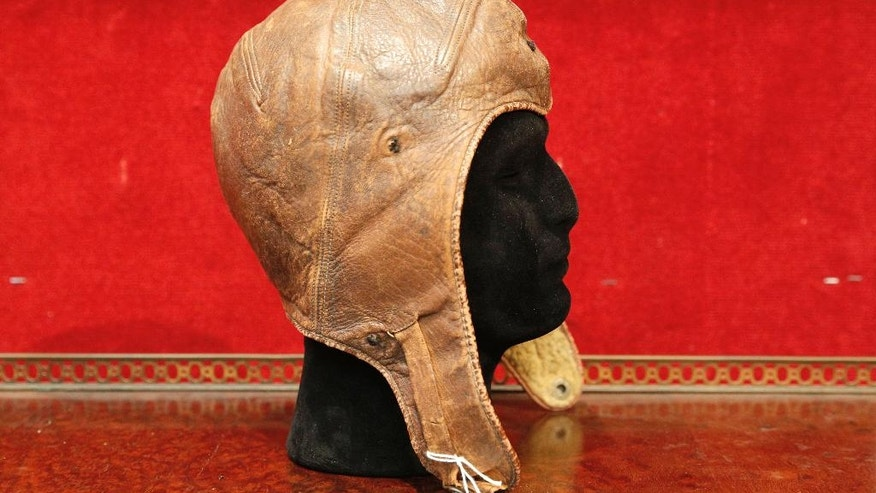 The leather cap of Captain Charles Lindbergh is pictured at the Drouot aucton house, Wednesday, Nov.16, 2016 in Paris. Lindbergh wore the aviation cap during his famous 33-hour transatlantic flight in 1927 from New York to Paris. Drouot's Wednesday sale is expected to fetch around $64 000-86 000. (AP Photo/Christophe Ena)