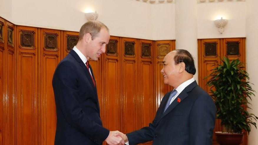 Britain's Prince William, left, shakes hands with Vietnamese Prime Minister Nguyen Xuan Phuc in Hanoi, Vietnam, Wednesday, Nov. 16, 2016. The Duke of Cambridge is on a first visit to where he will attend an international conference in the fight to protect elephants, rhinos and other endangered species. (AP Photo/Tran Van Minh)