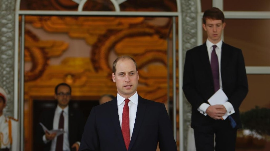Britain's Prince William, center, leaves the Government Office after having talks with Vietnamese Prime Minister Nguyen Xuan Phuc in Hanoi, Vietnam, Wednesday, Nov. 16, 2016. The Duke of Cambridge is on the first visit to where he will attend an international conference in the fight to protect elephants, rhinos and other endangered species. (AP Photo/Tran Van Minh)