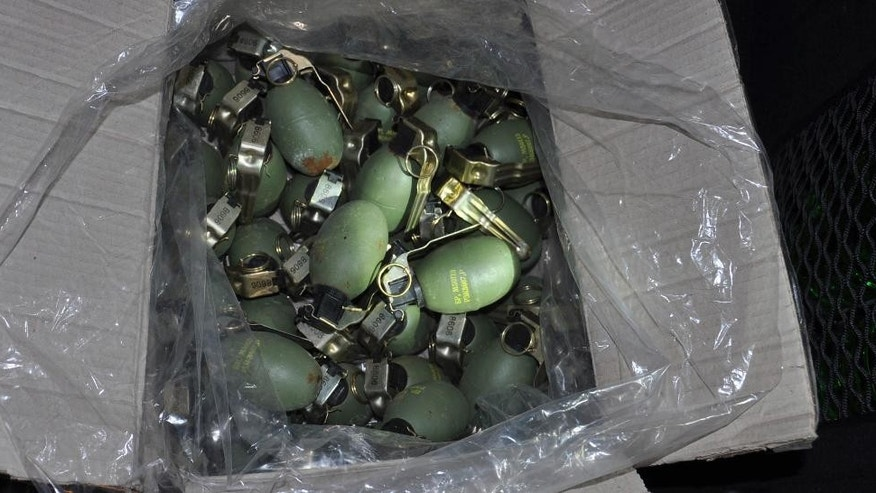 In this Tuesday, Nov. 15, 2016 photo provided by the Serbian Ministry of Interior, hand grenades seized by the Serbian police are boxed at an undisclosed location in northern Serbia, close to the country's border with Croatia. Serbian police said Wednesday Nov. 16 they have arrested 10 people suspected of arms-trafficking and seized the biggest quantity of weapons since 2000, including rocket launchers, anti-tank mines and automatic guns. (Serbian Ministry of Interior via AP)
