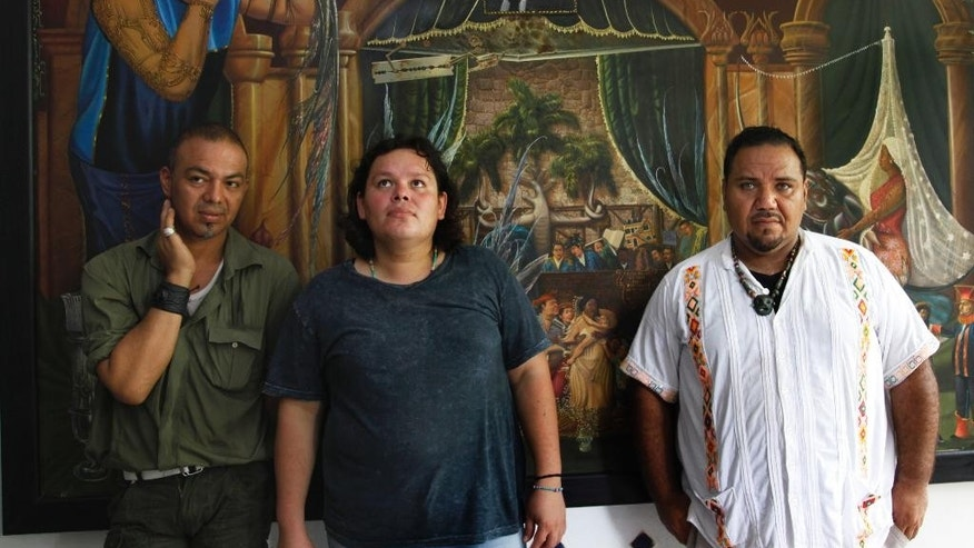 In this July 2, 2016 photo, Luis Edgardo Charnichart Ortega, left, Evanibaldo Larraga Galvan, center, and Juan Carlos Soni Bulos stand in Soni's terrace at his home, in Tanquian de Escobedo, San Luis Potosi, Mexico. The three men were detained by Mexican Marines, tortured and spent more than a year in prison on weapons and drug charges, without trial until a judge in March 2015 threw out the case. (AP Photo/Marco Ugarte)