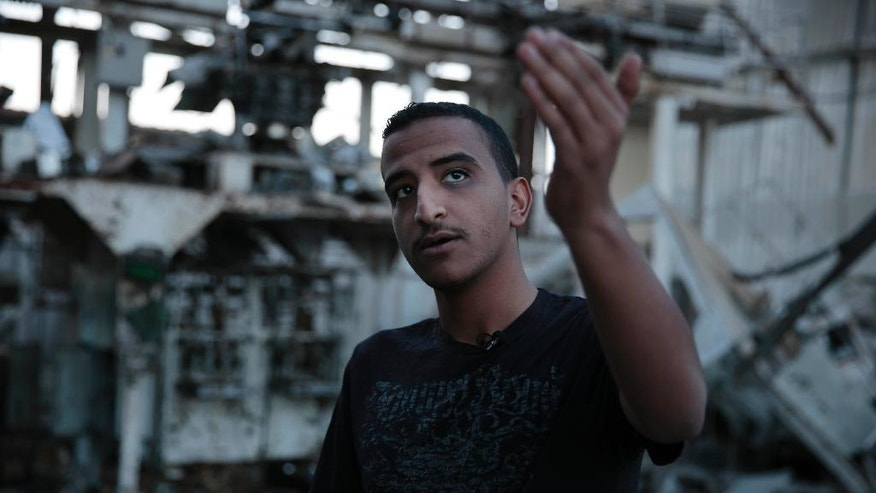 In this Oct. 4, 2016 photo, factory manager, Mustafa Elaghil gives an interview to The Associated Press, in Sanaa, Yemen. In the air campaign by Saudi Arabia and its allies against Yemen's Shiite rebels, rights experts say there has been a pattern by the Saudi-led coalition in depending on faulty intelligence, failing to distinguish between civilian and military targets and disregarding the likelihood of civilian casualties. Experts say some of the strikes likely amount to war crimes. (AP Photo/Hani Mohammed)
