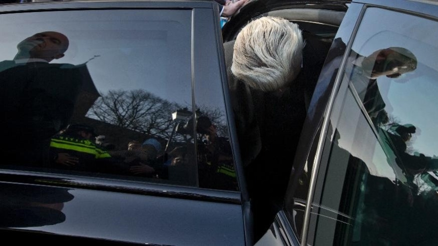 FILE - In this Saturday, Jan. 23, 2016 file photo Dutch firebrand Dutch lawmaker Geert Wilders gets into his car in the center of Spijkenisse, near Rotterdam, Netherlands. Dutch prosecutors have begun summing up their case against populist anti-Islam lawmaker Geert Wilders in his hate-speech trial that pits freedom of expression against the Netherlands' anti-discrimination laws. (AP Photo/Peter Dejong, File)