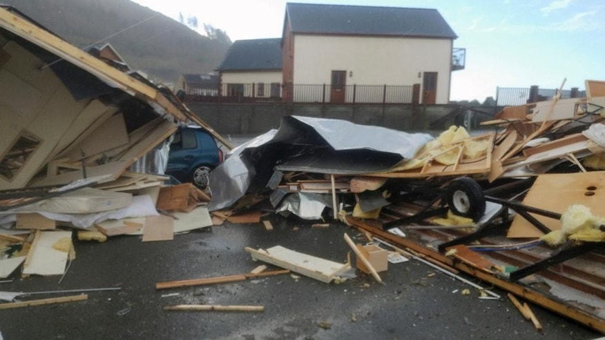 Mobile homes lay smashed in Aberystwyth, Wales, following extreme high winds which caused localised damage Thursday Nov. 17, 2016.  Authorities in Wales say hurricane-force winds have overturned caravans and toppled trees on to parked cars in a freak burst of weather focused on the seaside town of Aberystwyth. No injuries were reported. (Thomas Scarrott via AP)