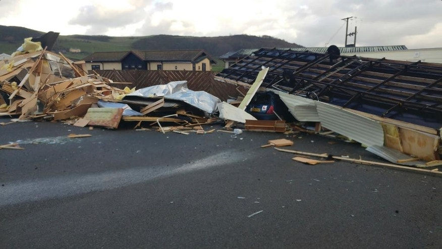 Mobile homes lay smashed at a holiday campsite in Aberystwyth, Wales, following extreme high winds which caused localised damage Thursday Nov. 17, 2016.  Authorities in Wales say hurricane-force winds have overturned caravans and toppled trees on to parked cars in a freak burst of weather focused on the seaside town of Aberystwyth. No injuries were reported. (Thomas Scarrott via AP)