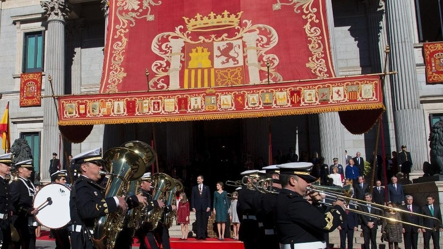 Spain's King Felipe and Queen Sofia watch a military parade after the new opening session of the Spanish parliament in Madrid, Spain, Thursday, Nov. 17, 2016. Spain's Prime Minister Mariano Rajoy will begin a second term in office, this time with a minority government after a parliamentary vote ended a 10-month political deadlock following two inconclusive elections. (AP Photo/Paul White)
