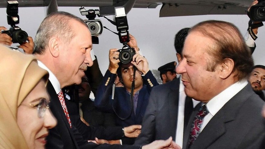 In this Wednesday, Nov. 16, 2016 photo provided by the Pakistan Press Information Department, Pakistan's Prime Minister Nawaz Sharif, right, receives Turkey's President Recep Tayyip Erdogan in Islamabad, Pakistan. Ahead of a visit by Turkey's president, Islamabad ordered 400 Turkish nationals affiliated with a chain of international schools in Pakistan to leave the country within 72 hours, officials said Wednesday. (Press Information Department via AP)
