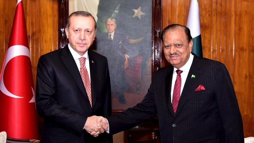In this Wednesday, Nov. 16, 2016 photo provided by the Pakistan Press Information Department, Pakistan's President Mamnoon Hussain right, receives Turkey's President Recep Tayyip Erdogan the President House in Islamabad, Pakistan. Ahead of a visit by Turkey's president, Islamabad ordered 400 Turkish nationals affiliated with a chain of international schools in Pakistan to leave the country within 72 hours, officials said Wednesday. (Press Information Department via AP)
