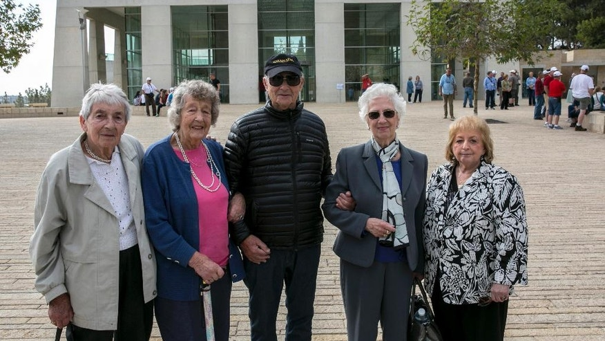 From left, Sonja Sternberg, her sister Gisela Feldman, Thomas Jacobson, Sonja Geismar, Eva Wiener passengers from the 1939 SS St. Louis trans-Atlantic ship, pose for a photograph during a visit to the Yad Vashem Holocaust memorial in Jerusalem Thursday, Nov. 17, 2016. The few remaining passengers from the famed 1939 SS St. Louis trans-Atlantic liner carrying nearly 1,000 Jewish refugees from Germany that was rejected by the United States and Cuba offer a unique perspective on today's refugee crisis. More than a quarter of the passengers ultimately perished in the Nazi death camps and the ship's saga became a symbol of Western indifference toward the victims of Nazi persecution. (AP Photo/Olivier Fitoussi) ISRAEL OUT