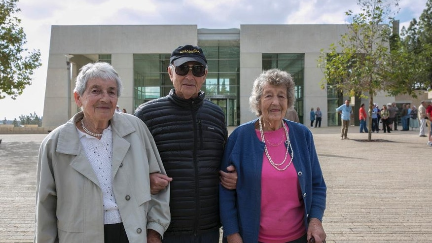 From left, Sonja Sternberg, Thomas Jacobson, Gisela Feldman, passengers from the 1939 SS St. Louis trans-Atlantic ship, pose for a photograph during a visit to the Yad Vashem Holocaust memorial in Jerusalem Thursday, Nov. 17, 2016. The few remaining passengers from the famed 1939 SS St. Louis trans-Atlantic liner carrying nearly 1,000 Jewish refugees from Germany that was rejected by the United States and Cuba offer a unique perspective on today's refugee crisis. More than a quarter of the passengers ultimately perished in the Nazi death camps and the ship's saga became a symbol of Western indifference toward the victims of Nazi persecution. (AP Photo/Olivier Fitoussi) ISRAEL OUT