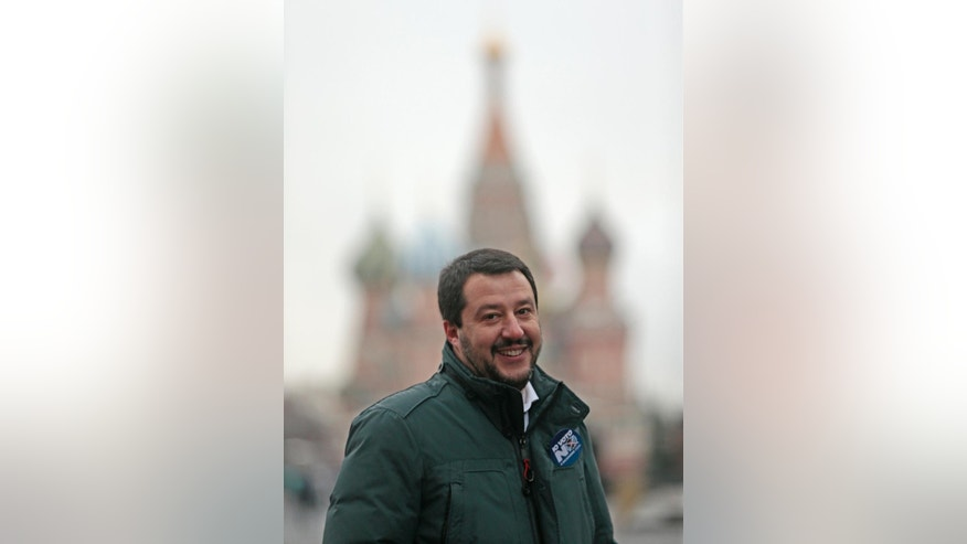 Italy's Northern League leader Matteo Salvini stands in Red Square, with St. Basil Cathedral in the back, in Moscow, Russia, Friday, Nov. 18, 2016. Salvini is in Russia to meet the Italian community in Russia as part of his campaign against an institutional referendum sponsored by Italian Premier Matteo Renzi's government to change the role of the Italian Senate as provided by the 1948 Italian Constitution. (AP Photo/Ivan Sekretarev)