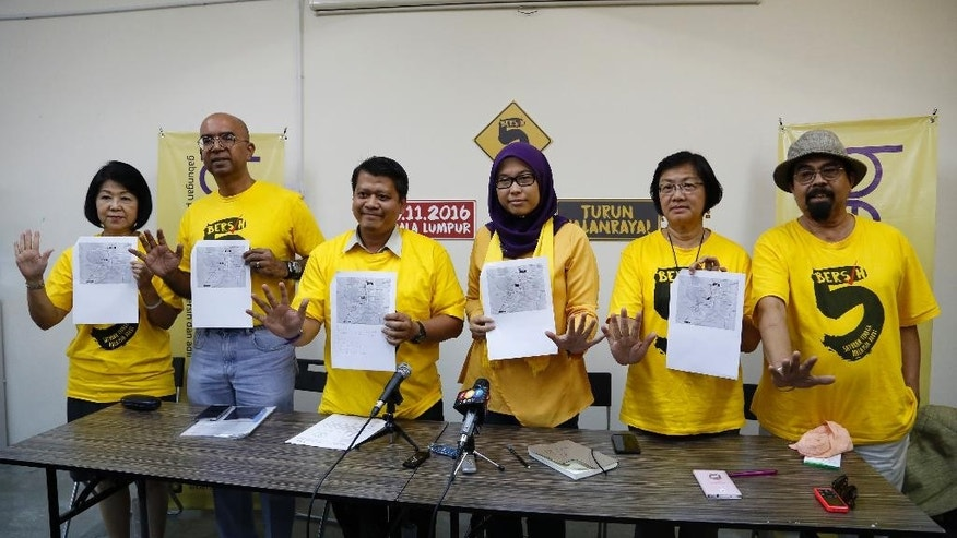 "In this picture taken Tuesday, Nov. 1, 2016, committee members from the Coalition for Clean and Fair Elections (Bersih) during a press conference at their office outside Kuala Lumpur, Malaysia. Malaysian Police raided the ""Bersih"" office on the eve of a major rally demanding the resignation of Prime Minister Najib Abdul Razak. (AP Photo/Lim Huey Teng)"