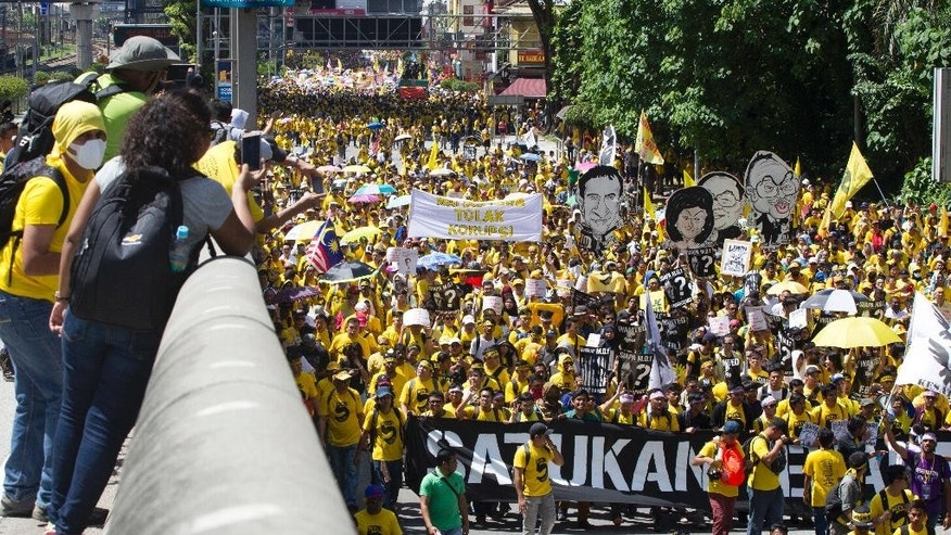 "Activists from the Coalition for Clean and Fair Elections (Bersih), march during a rally in Kuala Lumpur, Malaysia, Saturday, Nov. 19, 2016.  Malaysian police detained 12 activists and tightened security ahead of the rally Saturday by electoral reform group Bersih seeking Prime Minister Najib Razak's resignation over a financial scandal. Bersih means ""clean"" in the Malay language. (AP Photo/Lim Huey Teng)"