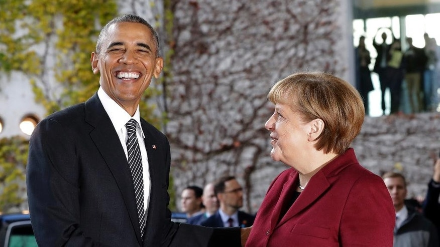 U.S. President Barack Obama, left, is welcomed by German Chancellor Angela Merkel prior to a meeting of the government heads of Germany, France, Italy, Spain and Britain with U.S. President Obama in the chancellery in Berlin, Germany, Friday, Nov. 18, 2016. (AP Photo/Michael Sohn)