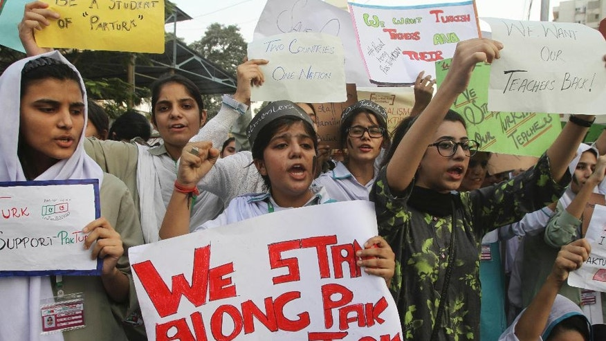 Pakistani students of the Pak-Turk International school protest in Karachi, Pakistan, Thursday, Nov. 17, 2016. Pakistan's order for 400 Turkish nationals, mostly schoolteachers and their families, to leave the country within 72 hours was being challenged in court on Thursday as hundreds of students took to the streets to denounce the expulsions. (AP Photo/Fareed Khan)